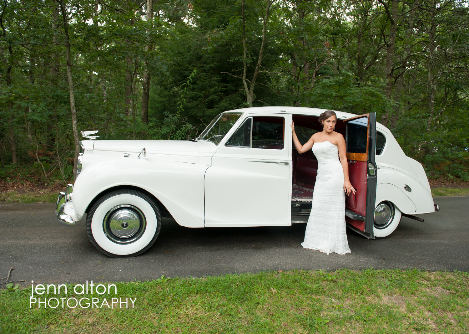 Bride posing with Rolls Royce before wedding, Cape Cod