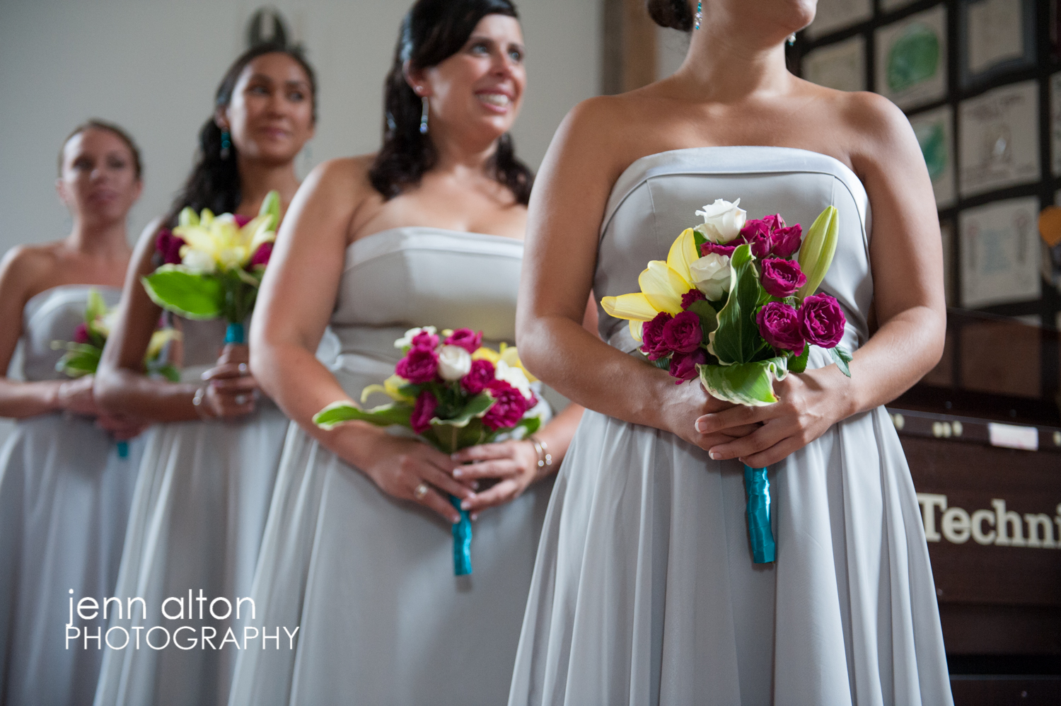 Bridesmaids during the ceremony with their bouquets, Mashpee Old Indian Meeting House