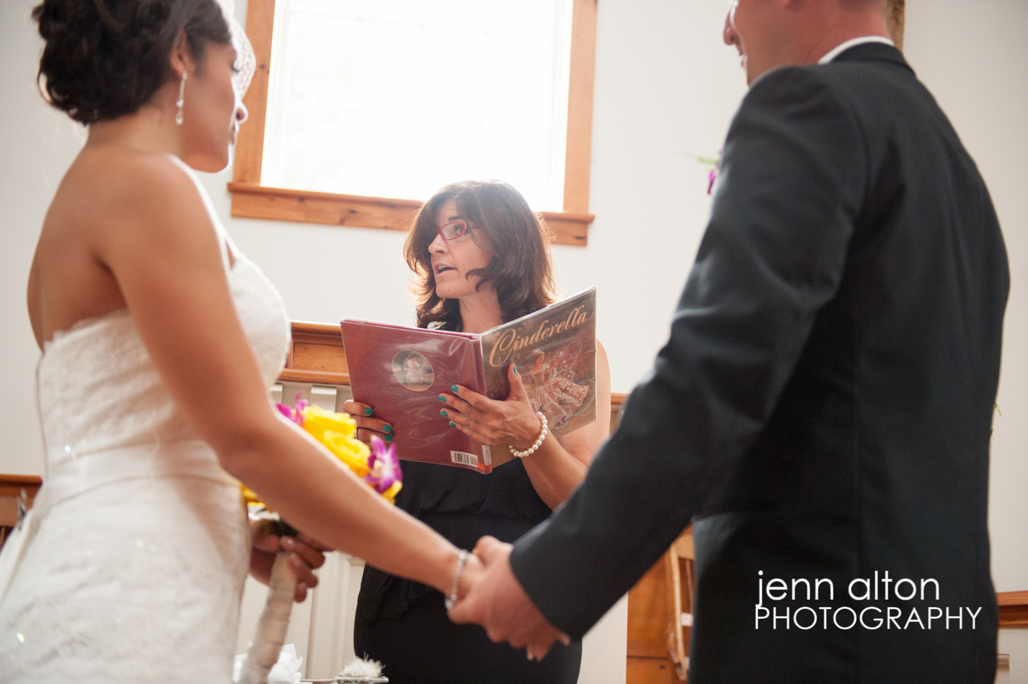 Cinderella story book during ceremony of Cape Cod Wedding, Mashpee Old Indian Meeting House