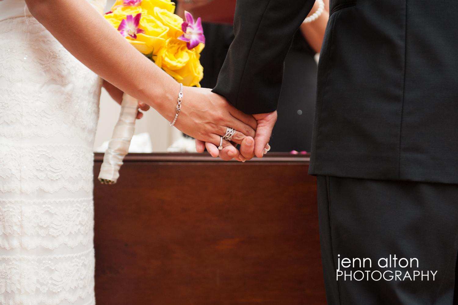 Bride and groom holding hands during Cape Cod Wedding, Mashpee Old Indian Meeting House
