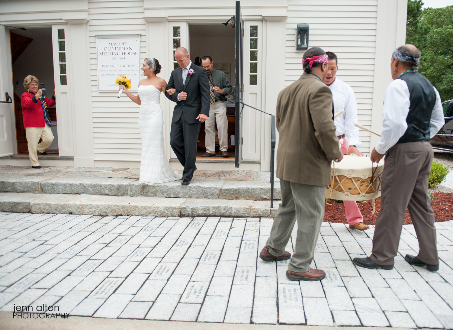 Drum playing during exit procession of Cape Cod Wedding, at Mashpee Old Indian Meeting House