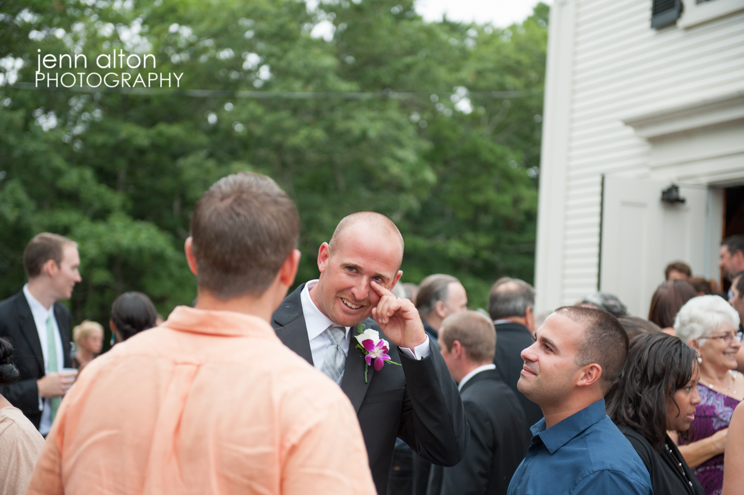 Groom accepting congratulations and becoming emotional after the ceremony, Cape Cod Wedding.