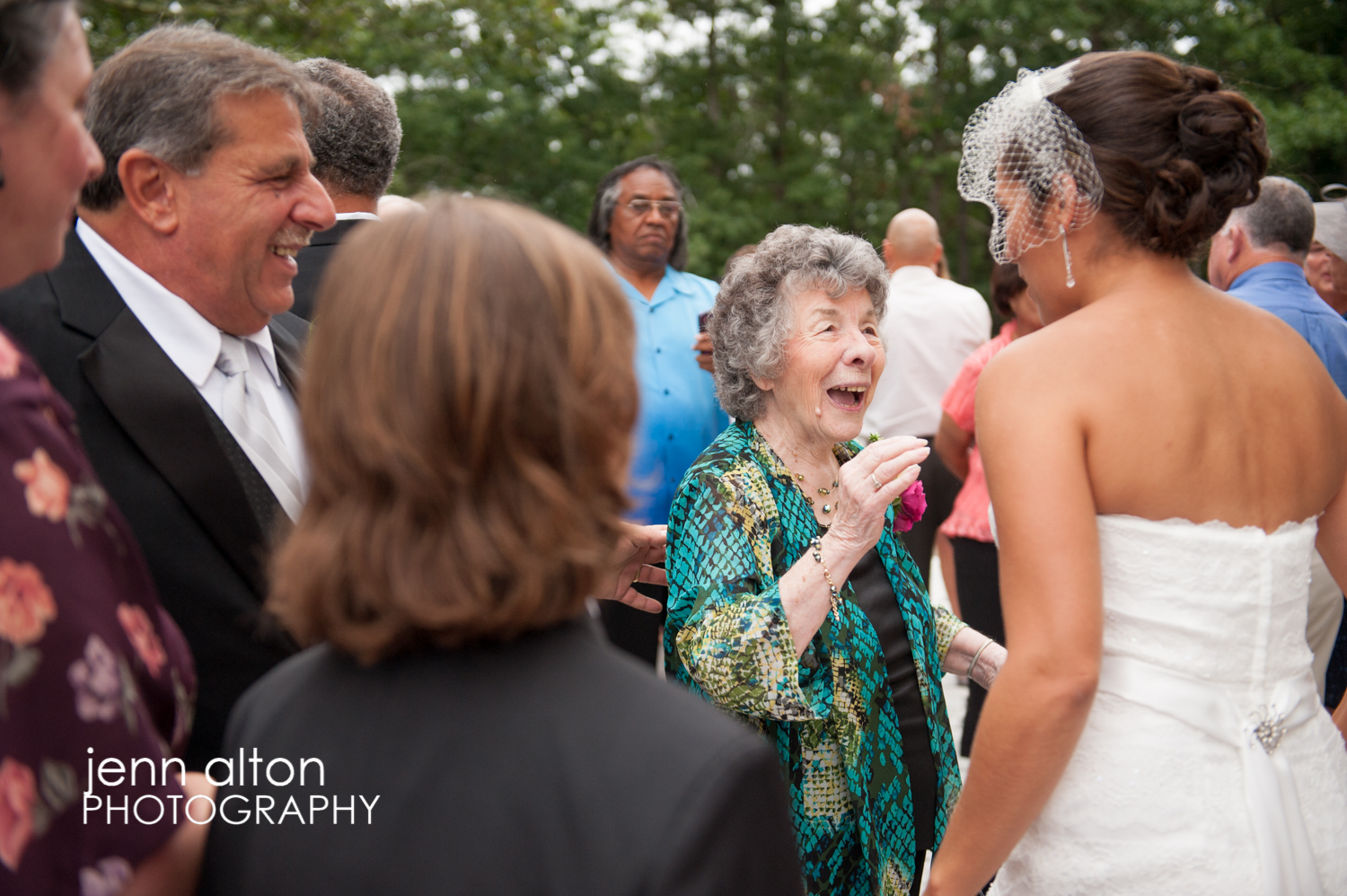 Bride accepting congrats from family and friends after ceremony, Cape Cod Wedding, Mashpee Old Indian Meeting House
