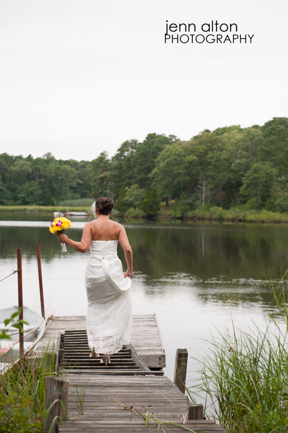 Bride on dock with bouquet, Cape Cod Wedding