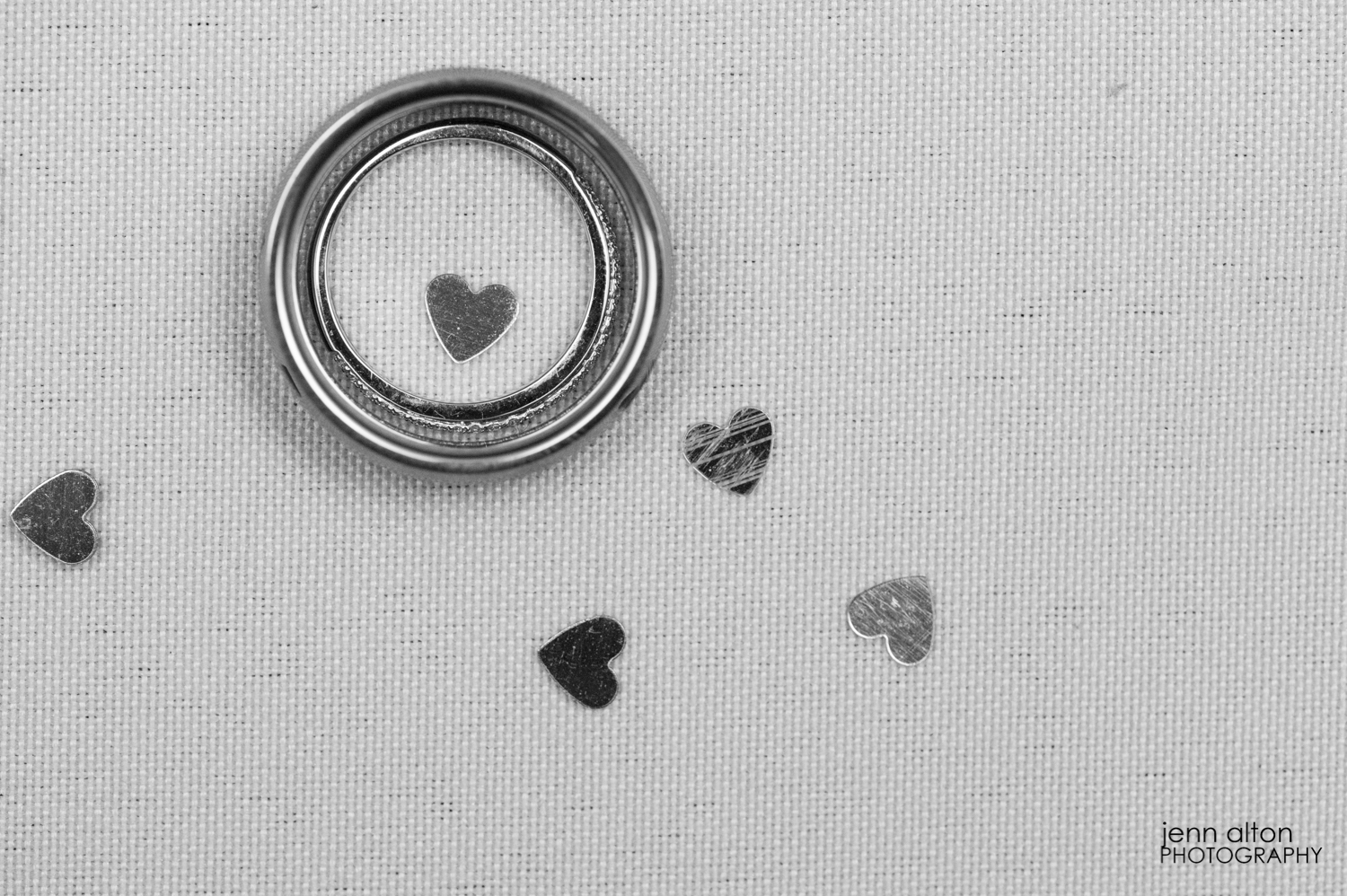 Wedding bands and heart confetti.