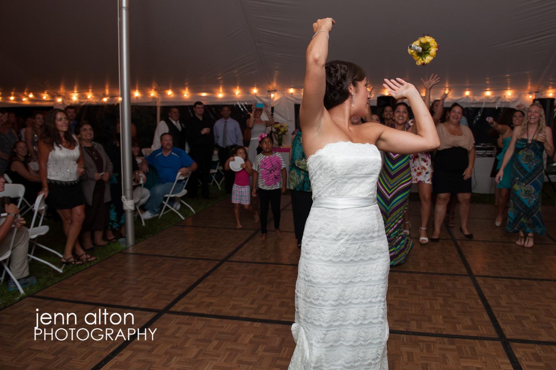 Bouquet toss, backyard reception, Cape Cod