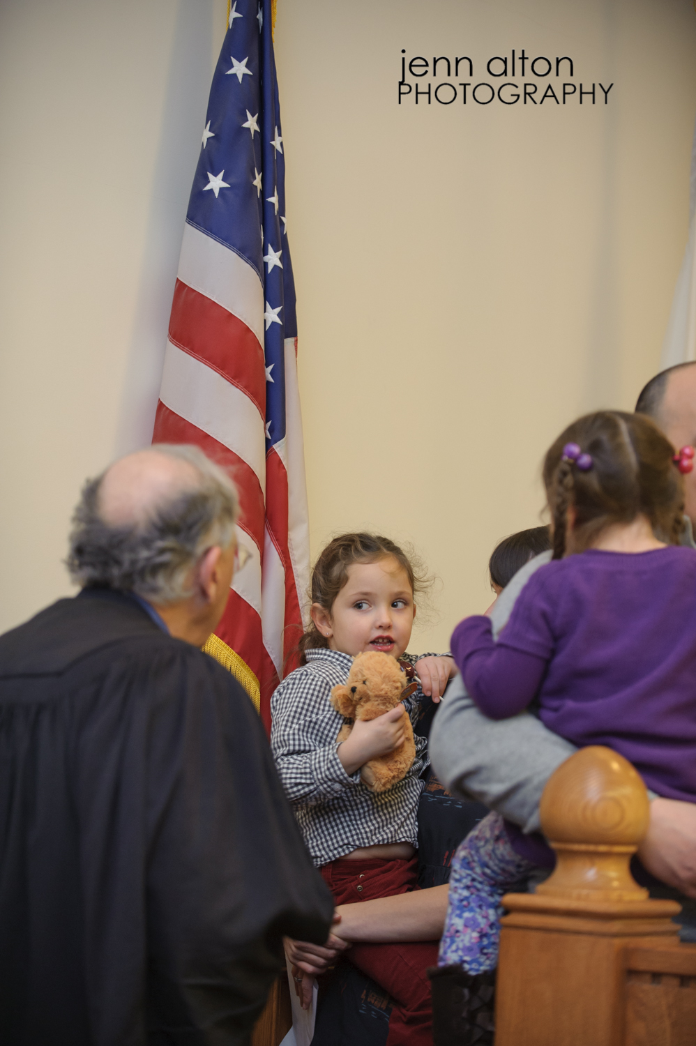 Family on adoption day in courtroom