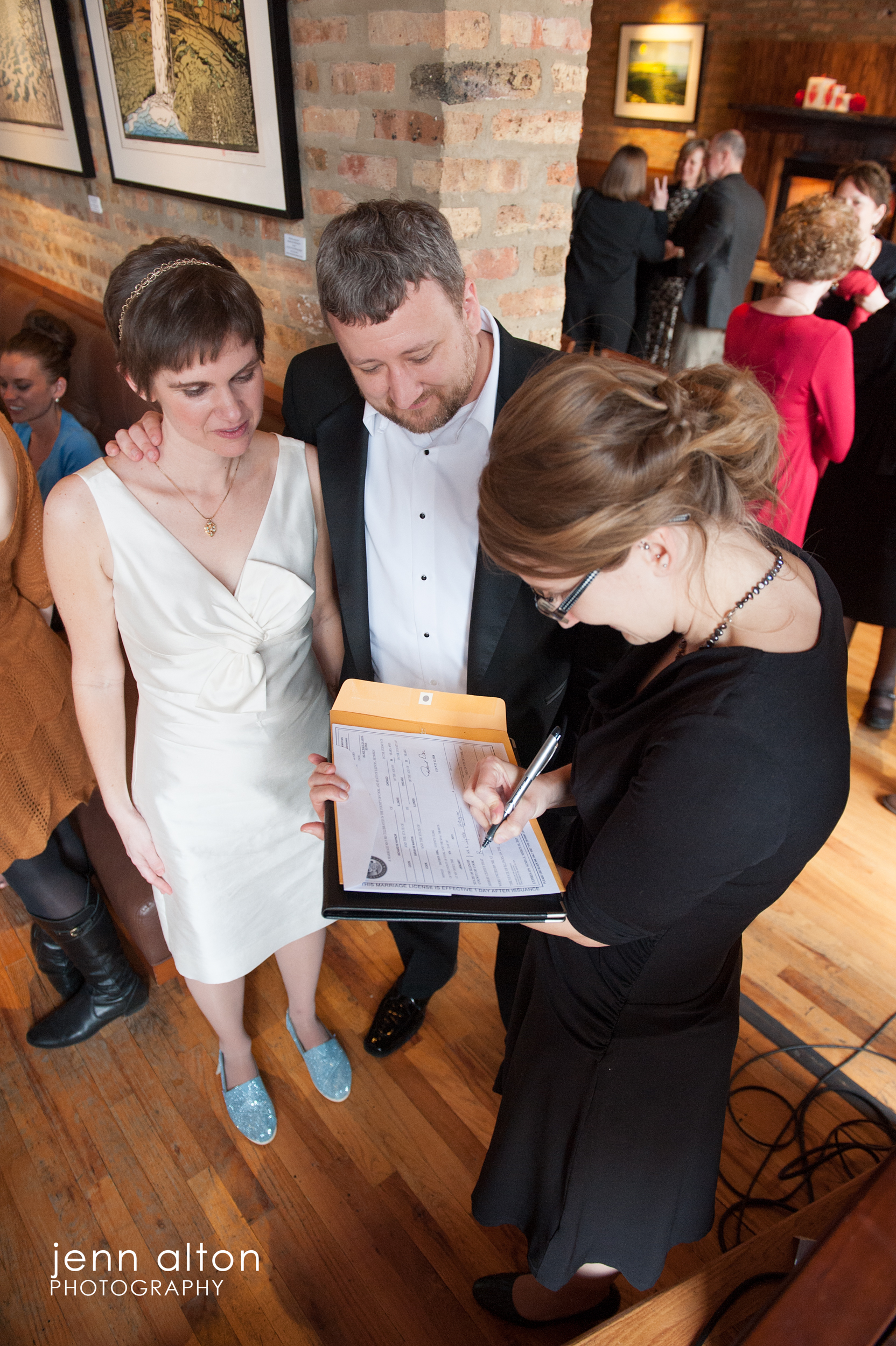Bride, groom and officiant, Signing offical paperwork,  Uncommon Ground on Devon, Chicago, IL.