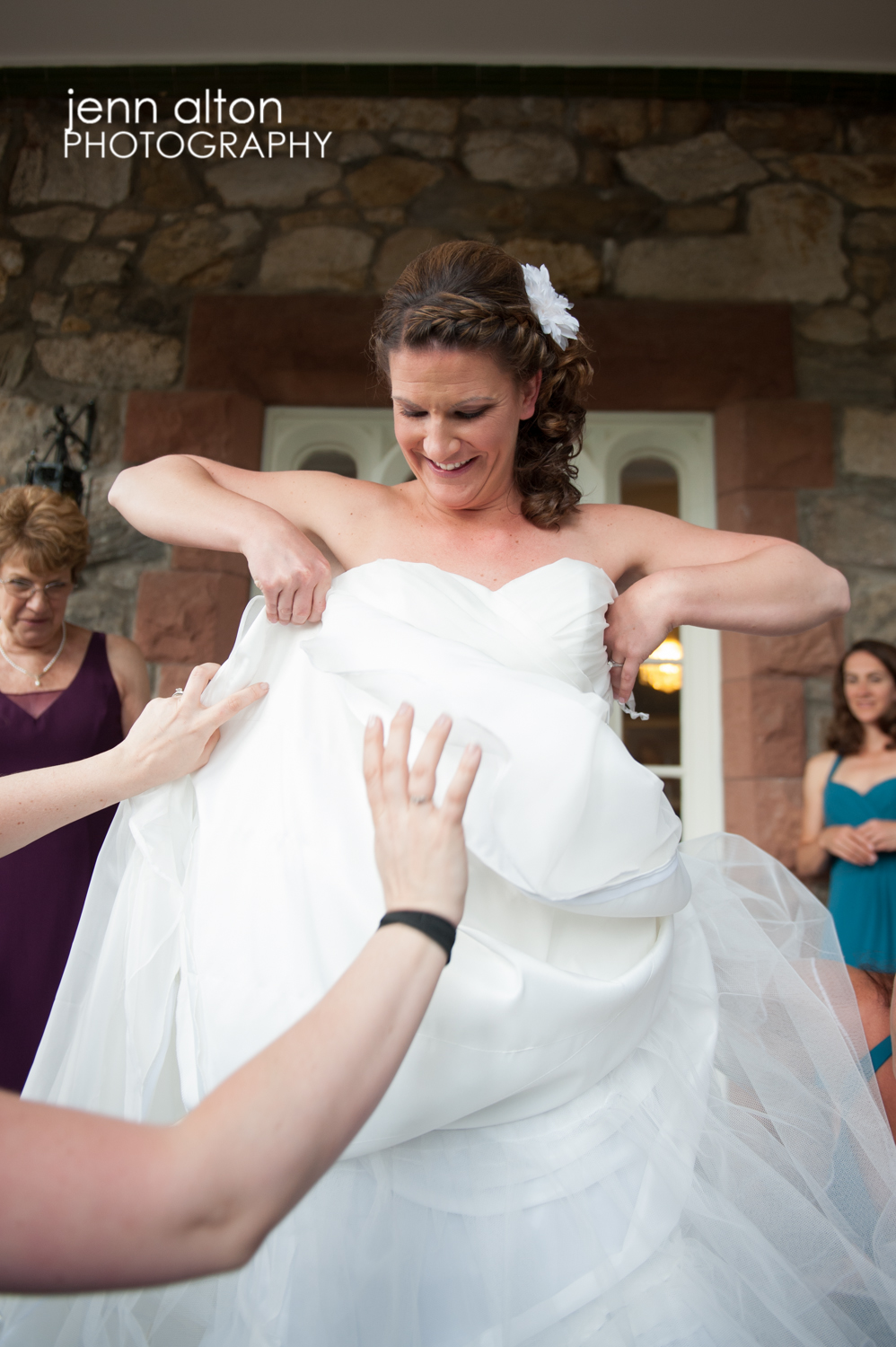 Bride putting on gown, Searles Castle
