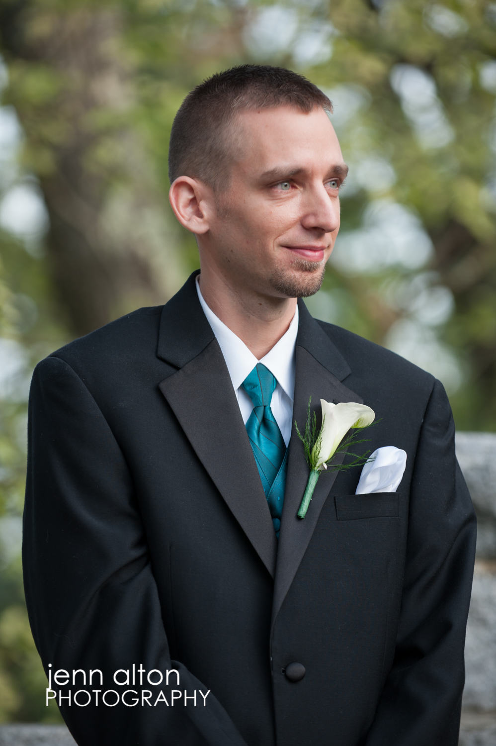 Groom's expression as bride approaches