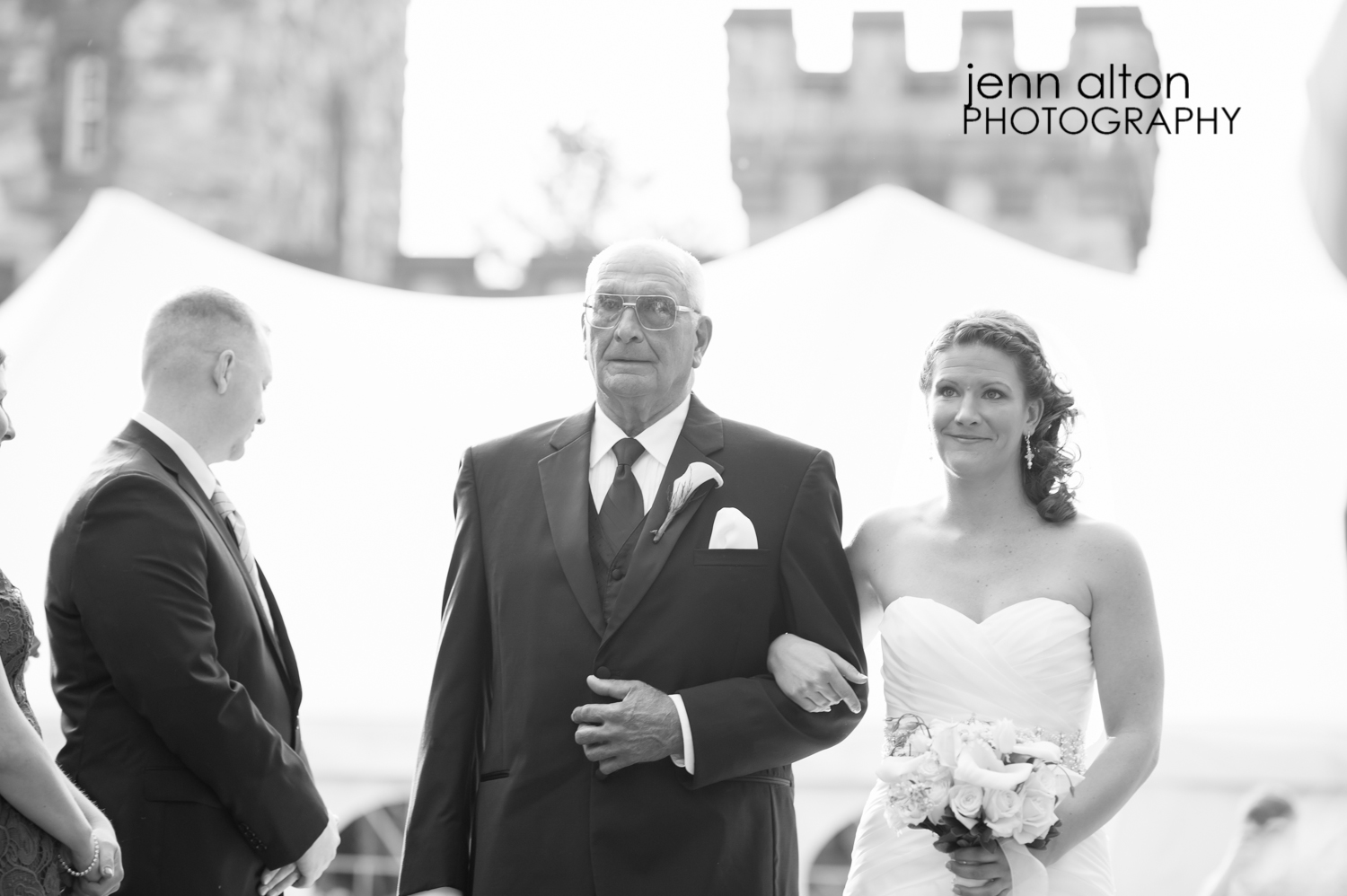 Father and bride walking into ceremony