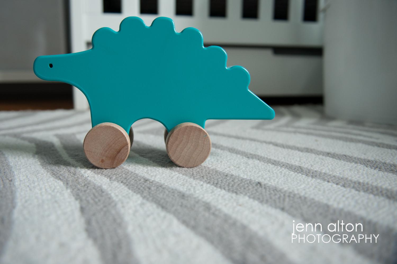 teal dinosaur wooden toy, baby nursery