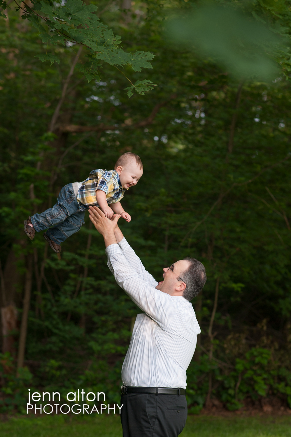 Little boy tossed in air by dad