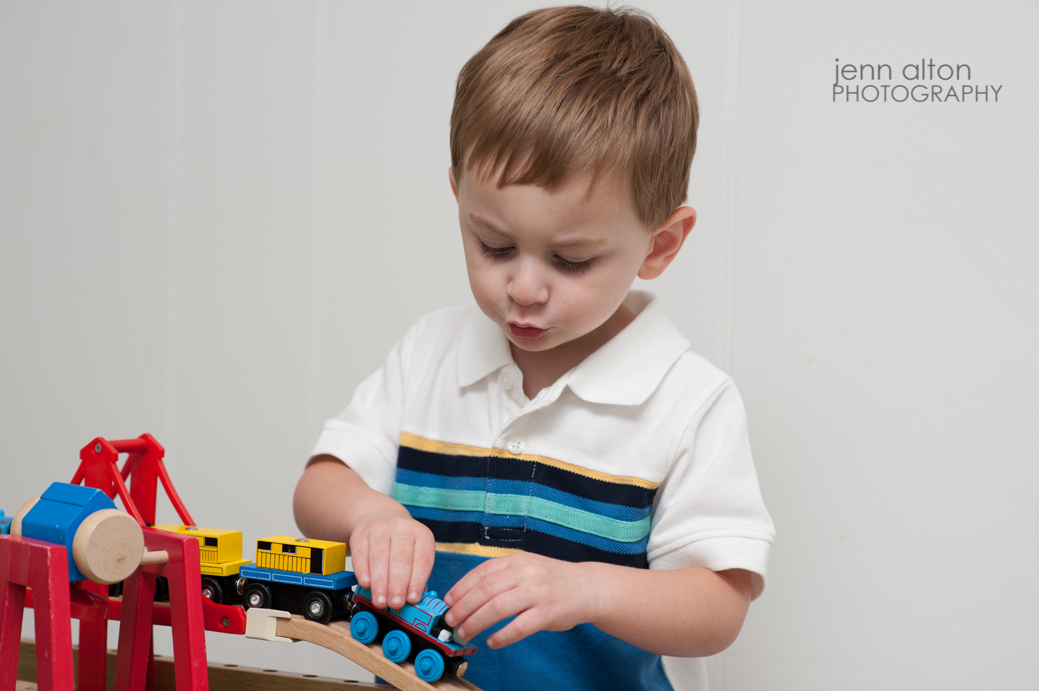 Toddler with train set