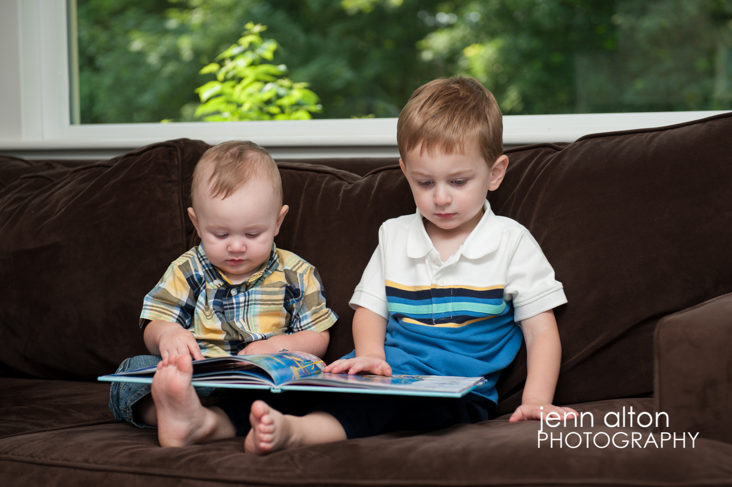 Brothers reading a book