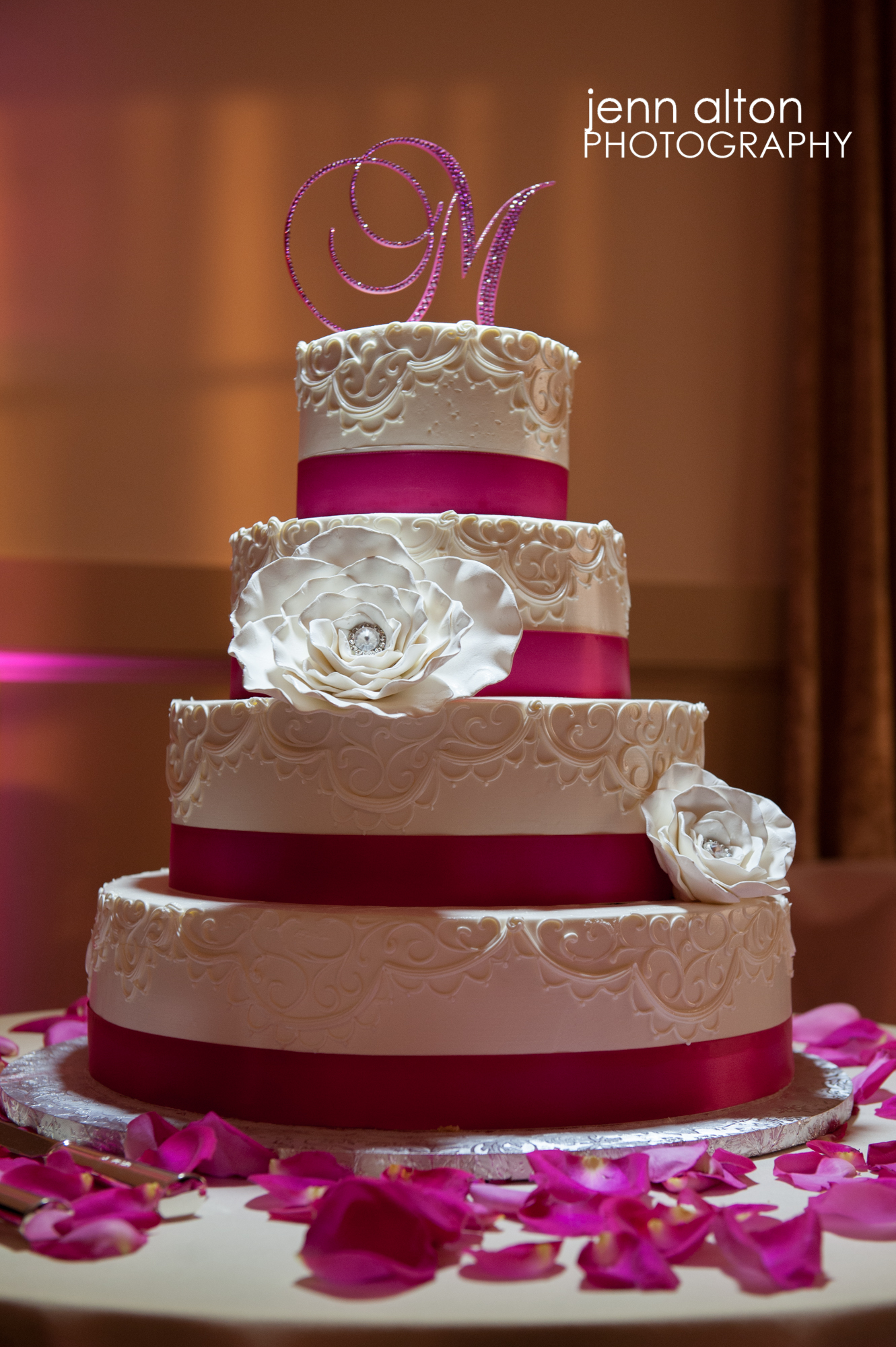 Pink accented wedding cake