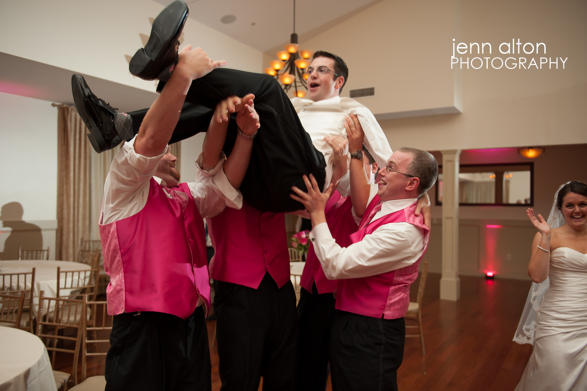 Groom and groomsmen celebrating, Wedding