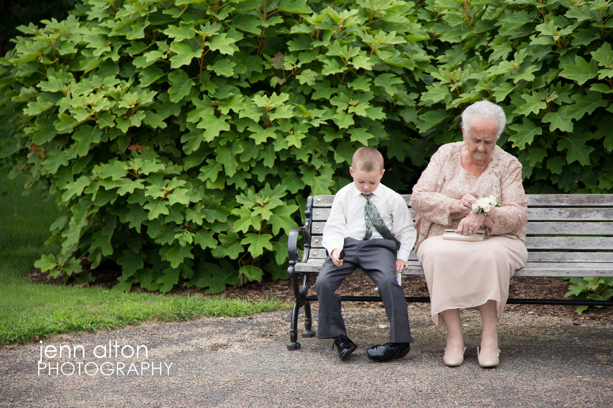 Candid family photo, grandmother and nephew on bench