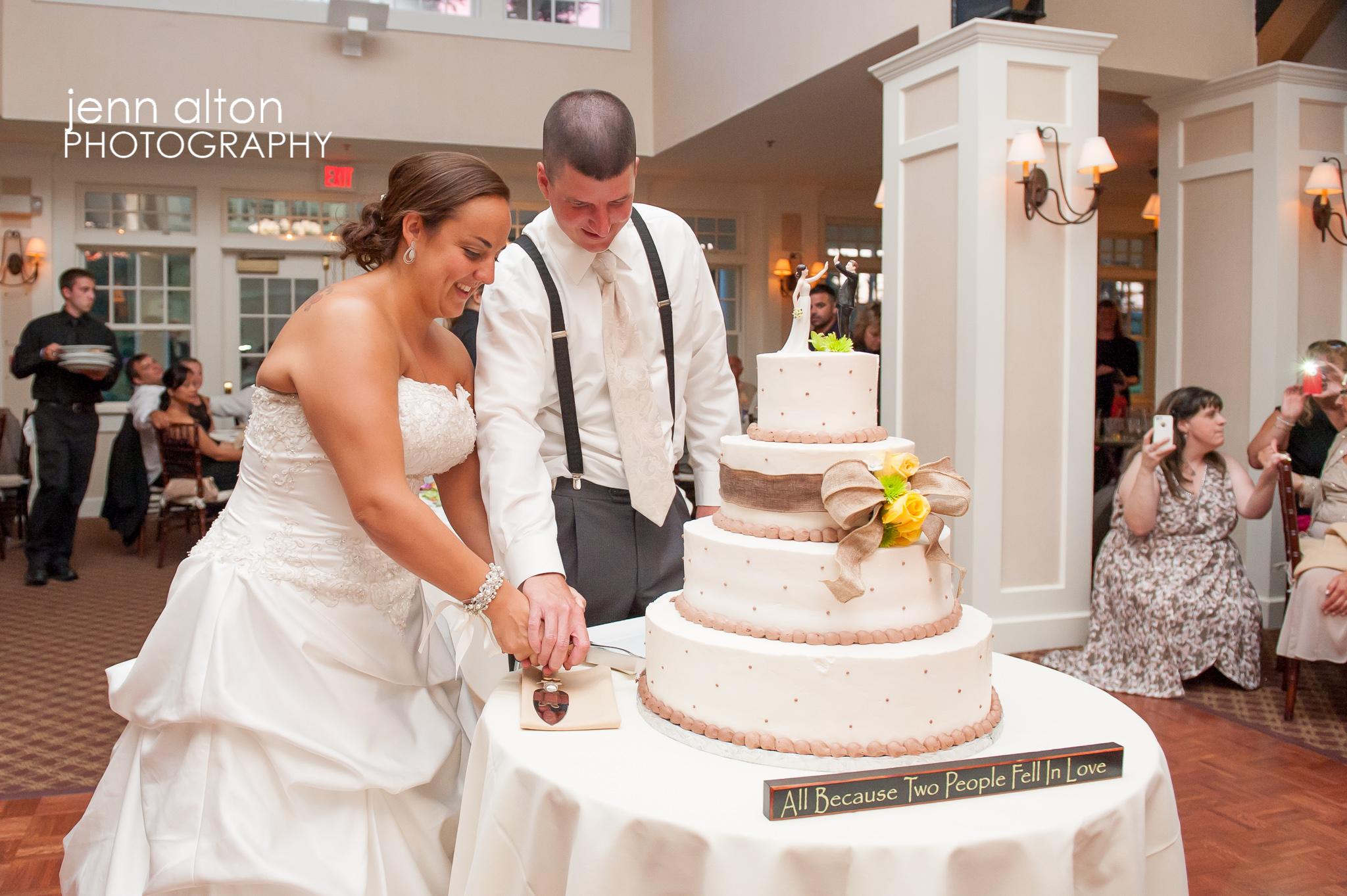 Bride and groom cake cutting, Pinehills Golf Club Wedding Reception
