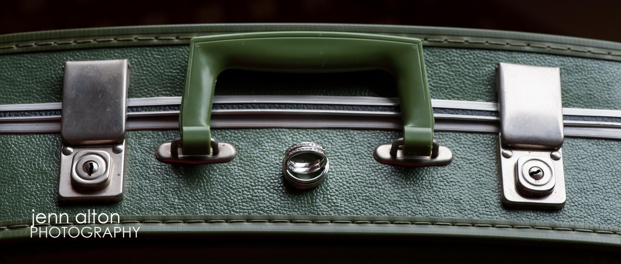 Wedding bands on vintage suitcase, detail