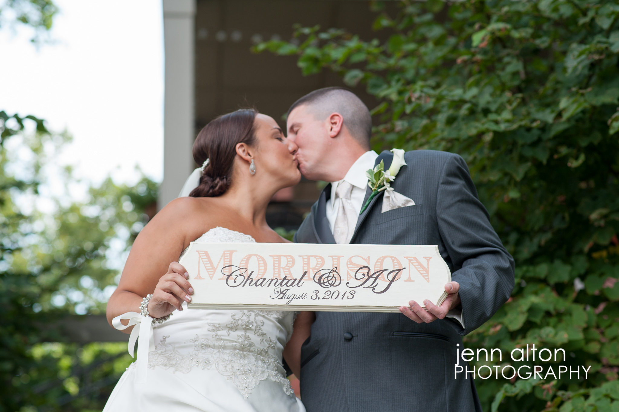 Bride and groom with custom sign portrait