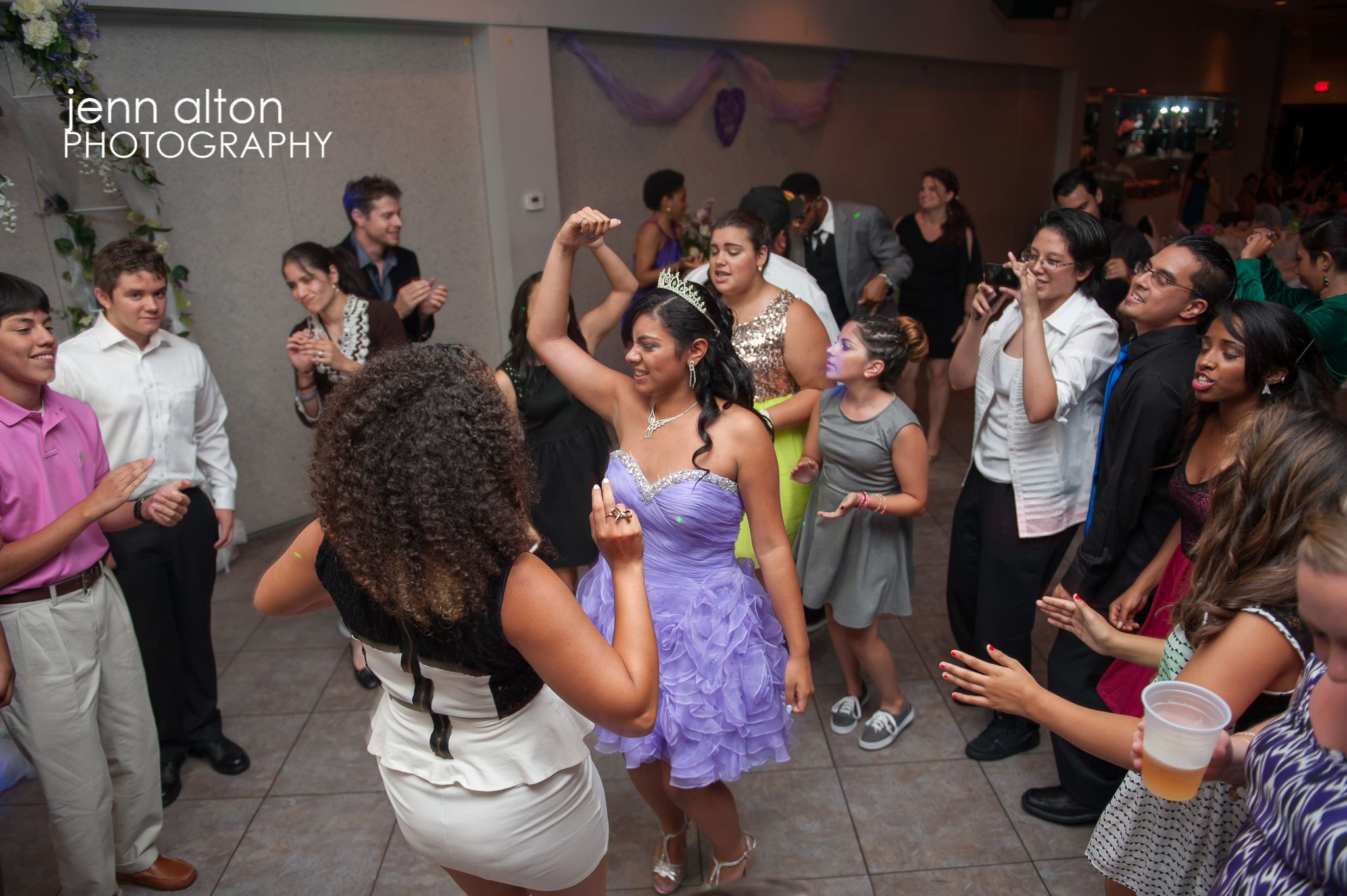 Quinceanera dancing at reception
