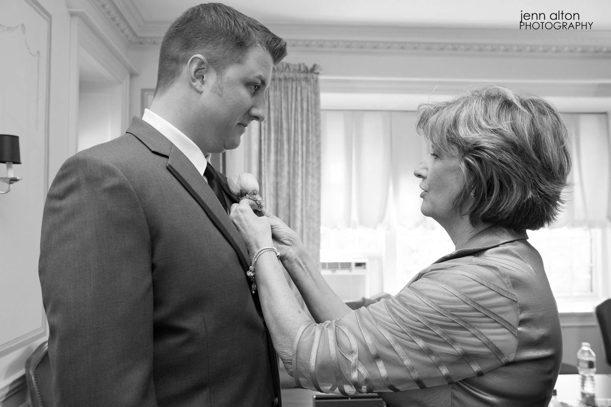 Groom and Groom's Mother attaching boutonniere, Henderson House