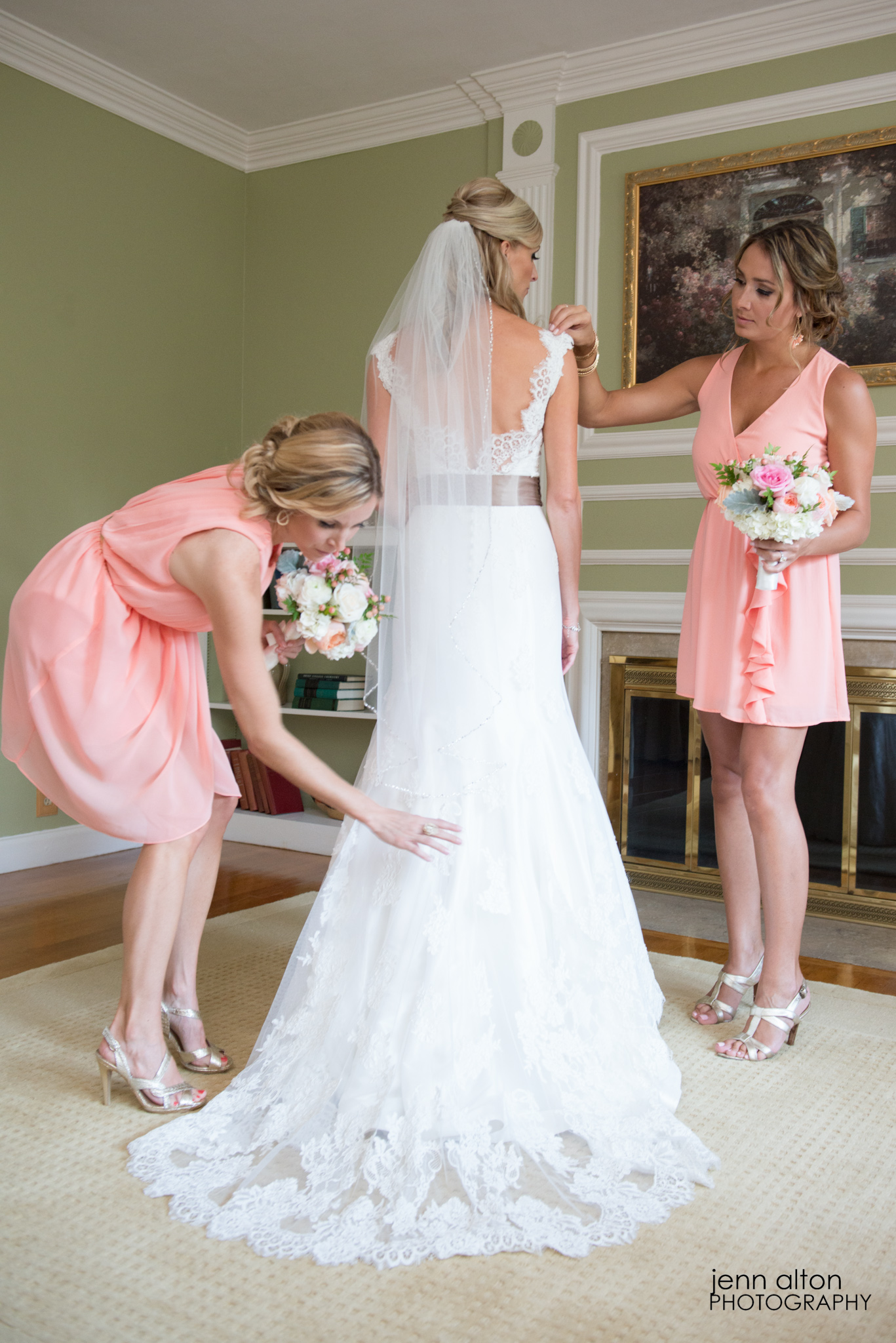 Final touches on dress with bride and maid of honors, Henderson House