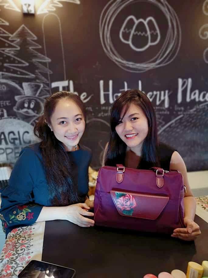 Elaine Wong & Nicole Chua with the painted bag