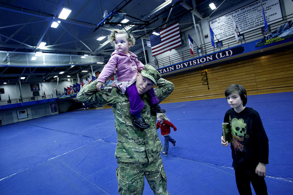 A sergeant that is going to Afghanistan is taking farewell of his kids at Fort Drum, New York.