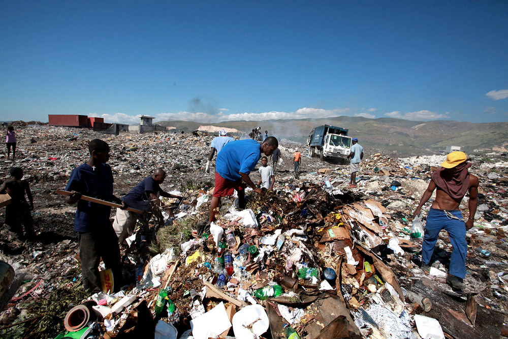Looking for food and scrap metals at the dump just outside Port-au-Prince.