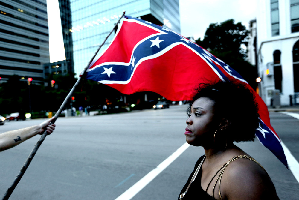 July 2015. Protesters for and against keeping the Confederate flag on the grounds of the Statehouse in Columbia, South Carolina.