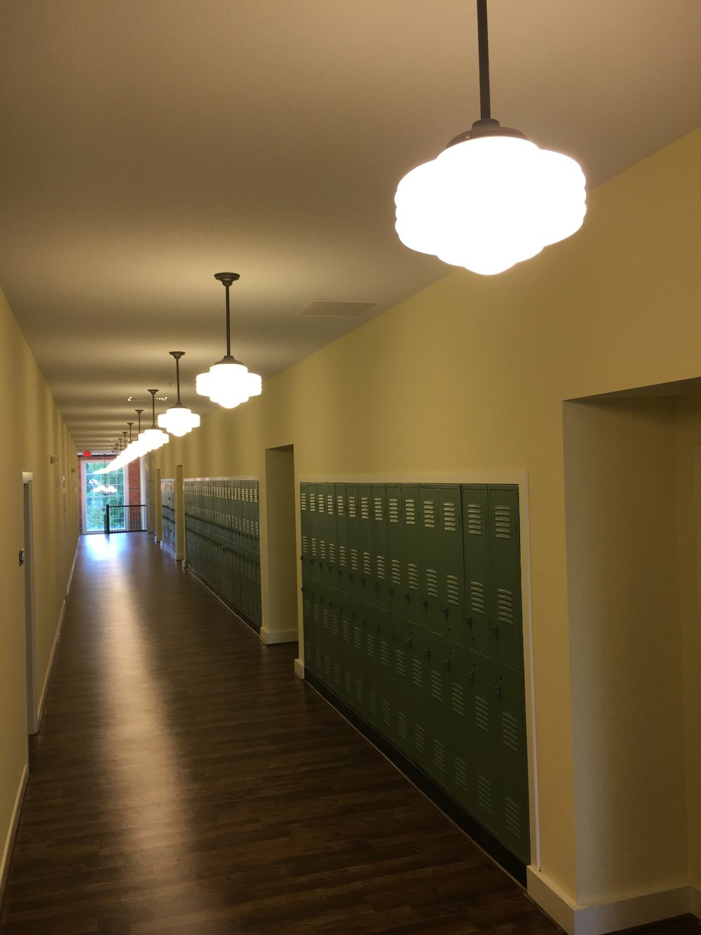 Resident corridors with lockers saved from the original school.