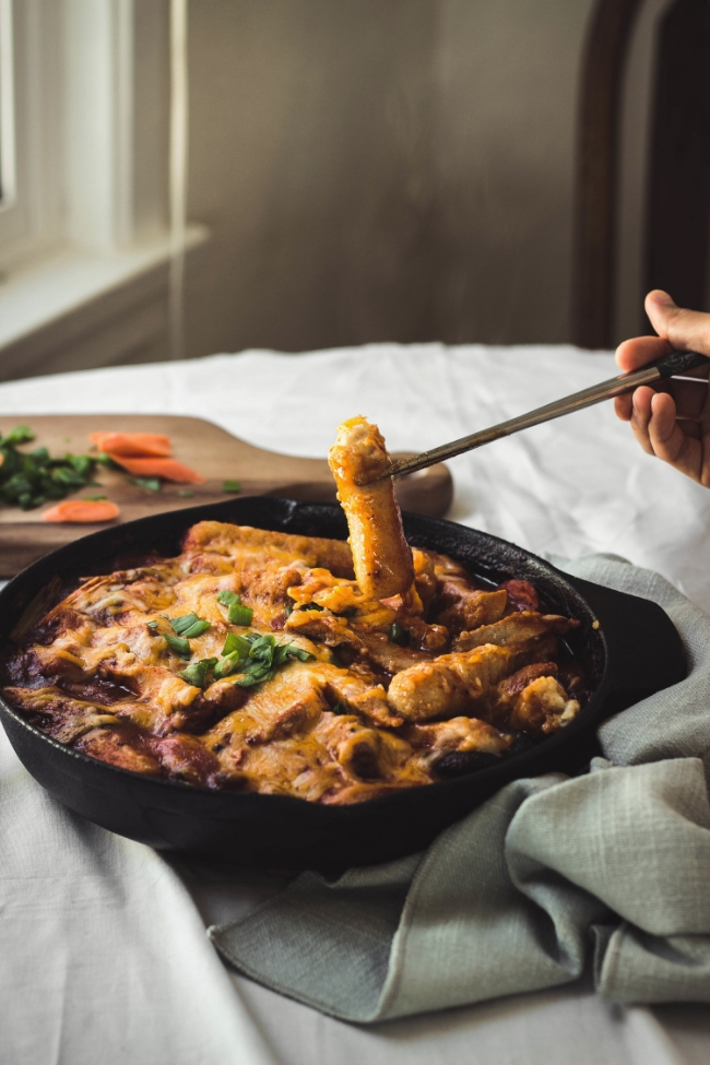 Cheese and Pork Tteokbokki in cast iron skillet with homemade brown rice tteok | fit for the soul