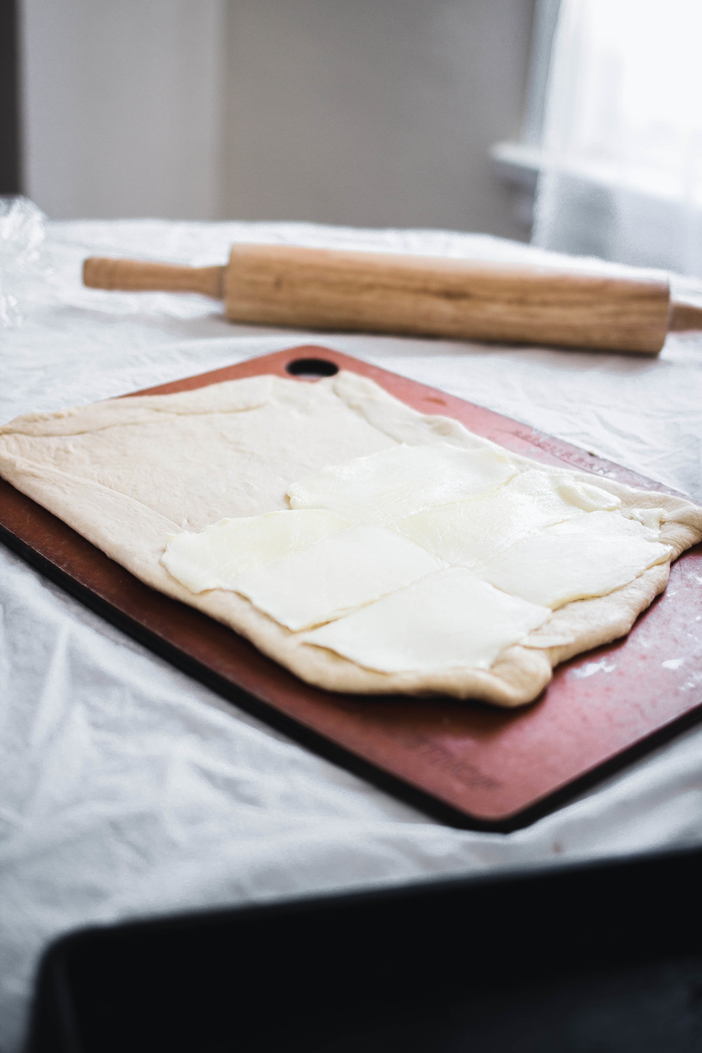 How to make flaky danish pastry from scratch-place butter sheet on dough