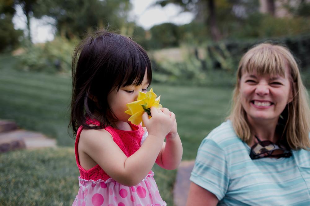 Selah smelling yellow flower.jpg
