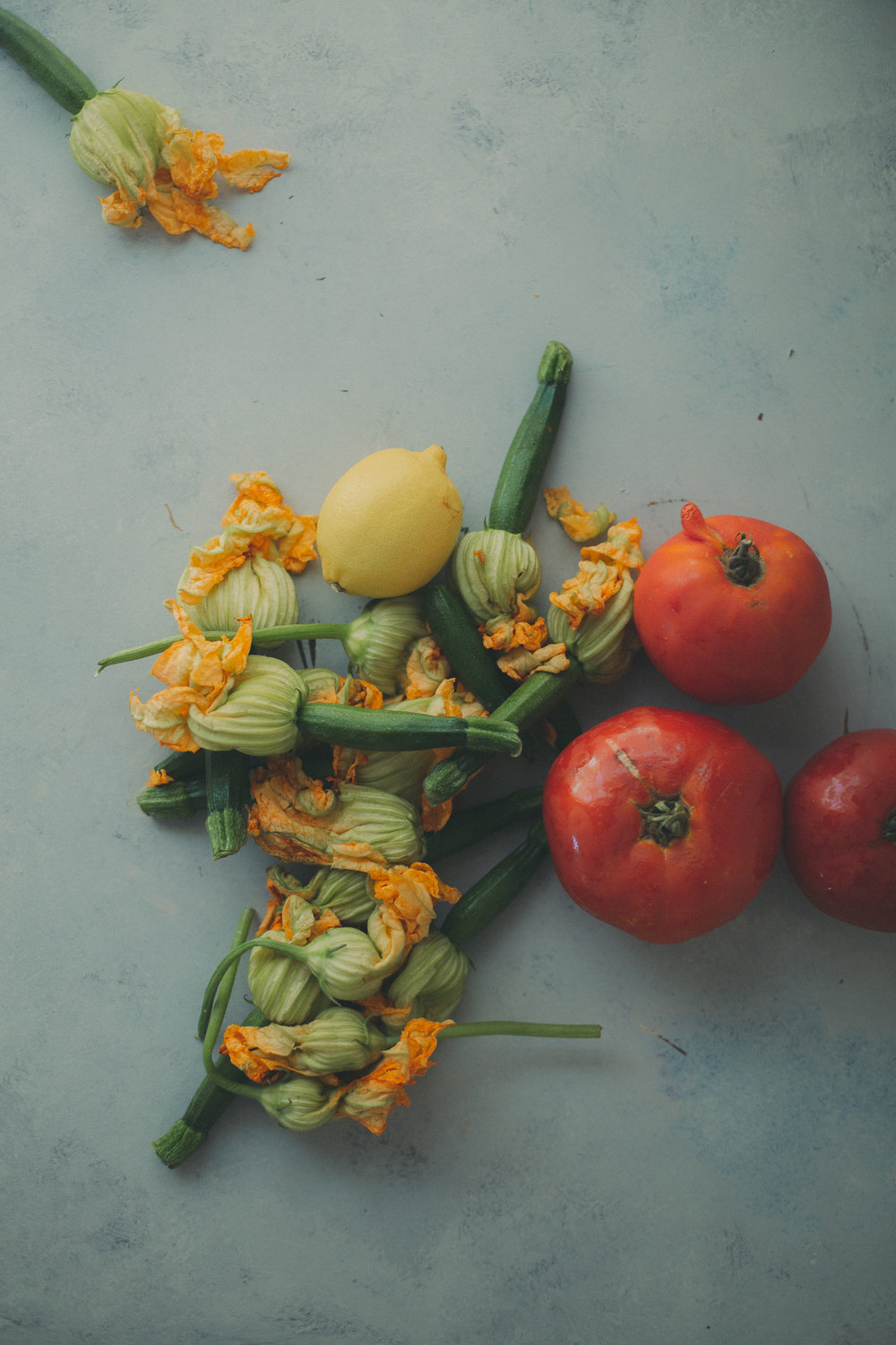 zucchini blossoms and tomatoes still life | from scratch, mostly