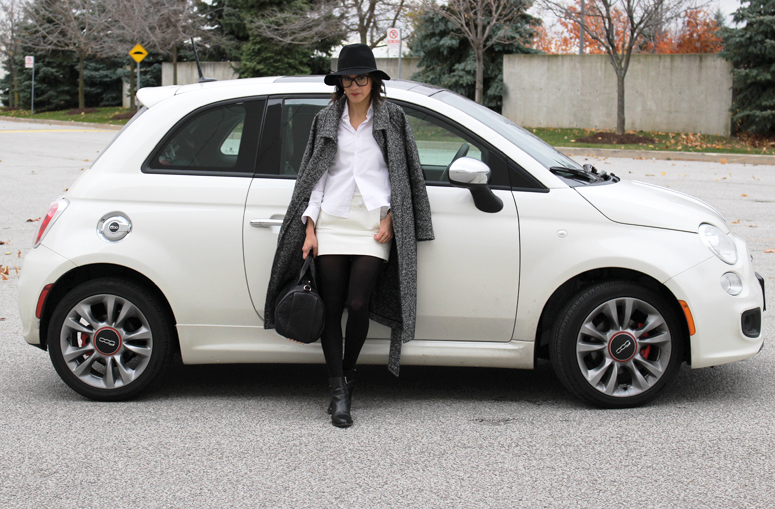WoahStyle.com | Aritzia Jacoby coat, Comme des Garcons heart logo dress shirt, Alexander Wang Rocco with rose gold hardware, Alexander Wang black ankle boots, Target hat, Chanel glasses, White Bianco Pearl Fiat 500 Sport with red leather interior.