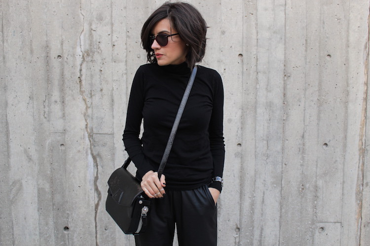 WoahStyle.com | All black street style. Alexander Wang trifold bag, faux leather trousers and black turtleneck. Short tousled hair.