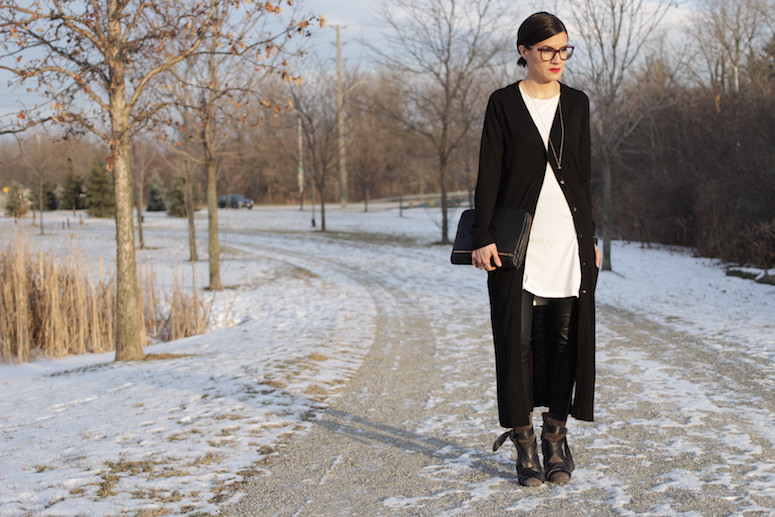 WoahStyle.com | Isabel Marant Angie boots, leather leggings, white tunic and long black cardigan from Zara, Alexander Wang Fumo clutch and Chanel glasses. #streetstyle #blackandwhitestyle