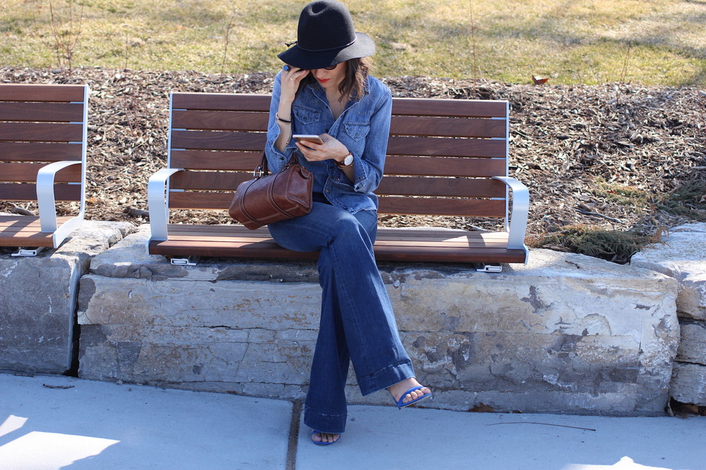 WoahStyle.com | Coachella In the City #StyleInspo #streetstyle Gucci, flares, denim on denim, Jbrand, Alexander wang, floppy hat