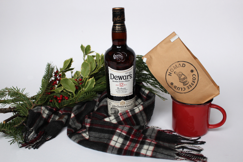 Dewar's 12 year old Scotch Whisky. Nomad Coffee Club subscription. Roots cotton plaid scarf (similar here).