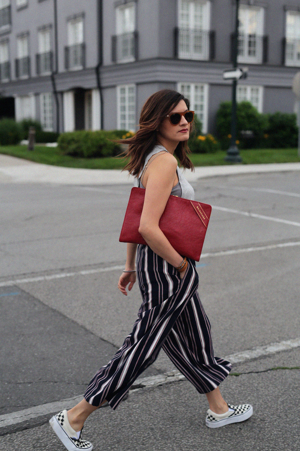 red balenciaga clutch, document holder, checkered vans and striped pants - street style_2090.jpg