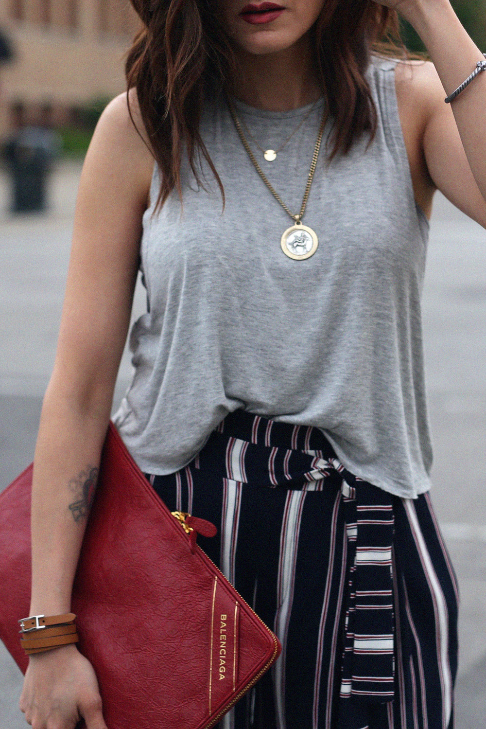 red balenciaga clutch, document holder, checkered vans and striped pants - street style_2129.jpg