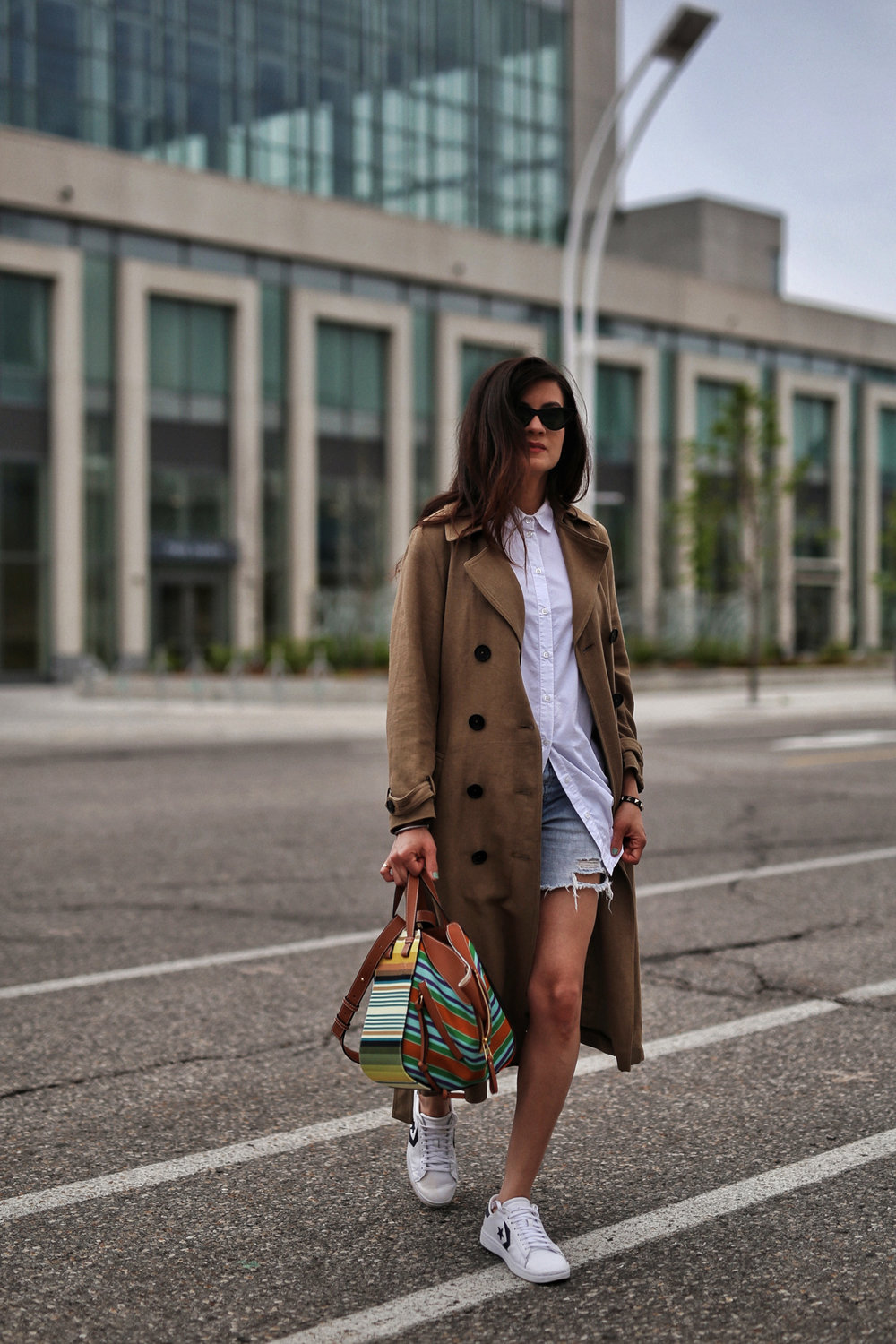 woahstyle.com 2018 - zara linen trench coat, free people cut off shorts, converse one stars, loewe striped small hammock bag, white button up shirt - toronto street style - hotel x - nathalie martin 11.jpg