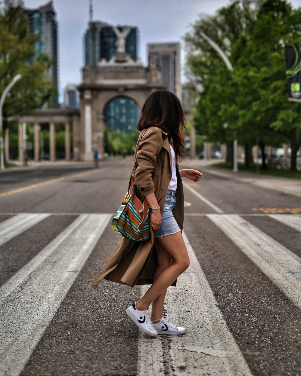 woahstyle.com 2018 - zara linen trench coat, free people cut off shorts, converse one stars, loewe striped small hammock bag, white button up shirt - toronto street style - hotel x - nathalie martin 9.jpg