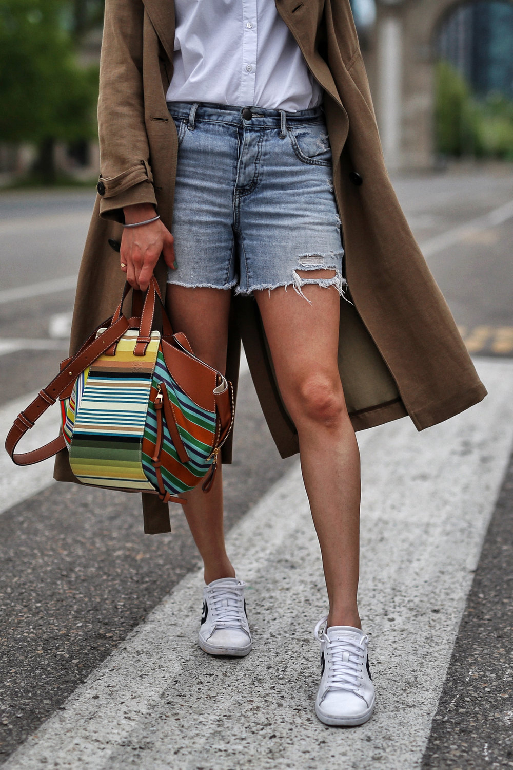 woahstyle.com 2018 - zara linen trench coat, free people cut off shorts, converse one stars, loewe striped small hammock bag, white button up shirt - toronto street style - hotel x - nathalie martin 10.jpg