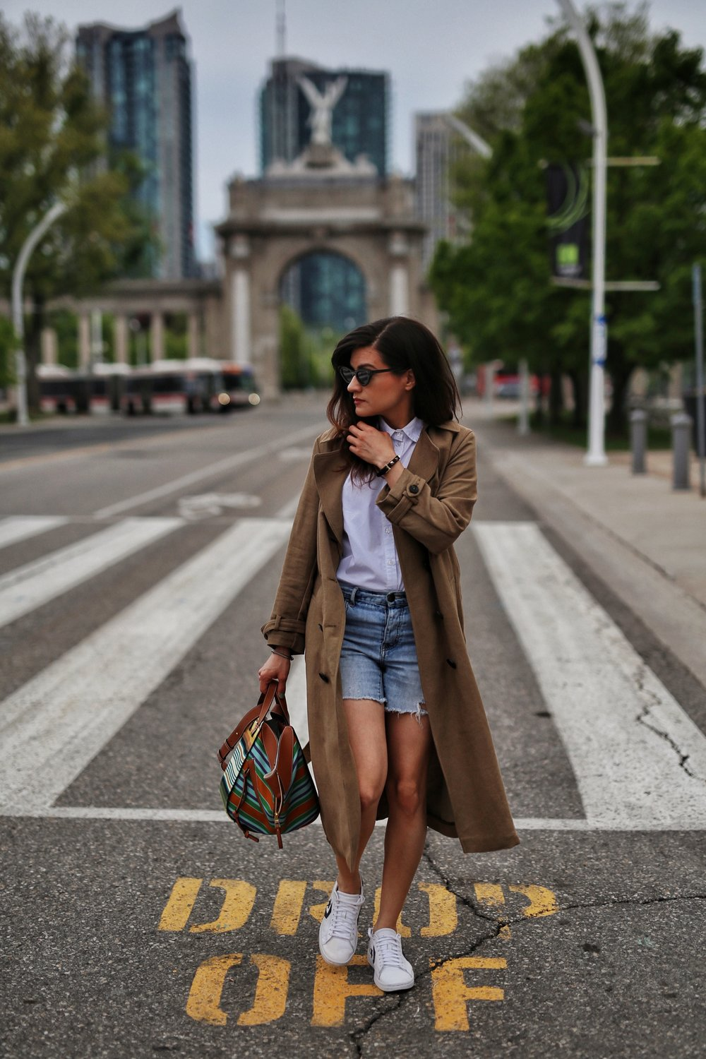 woahstyle.com 2018 - zara linen trench coat, free people cut off shorts, converse one stars, loewe striped small hammock bag, white button up shirt - toronto street style - hotel x - nathalie martin 12.jpg