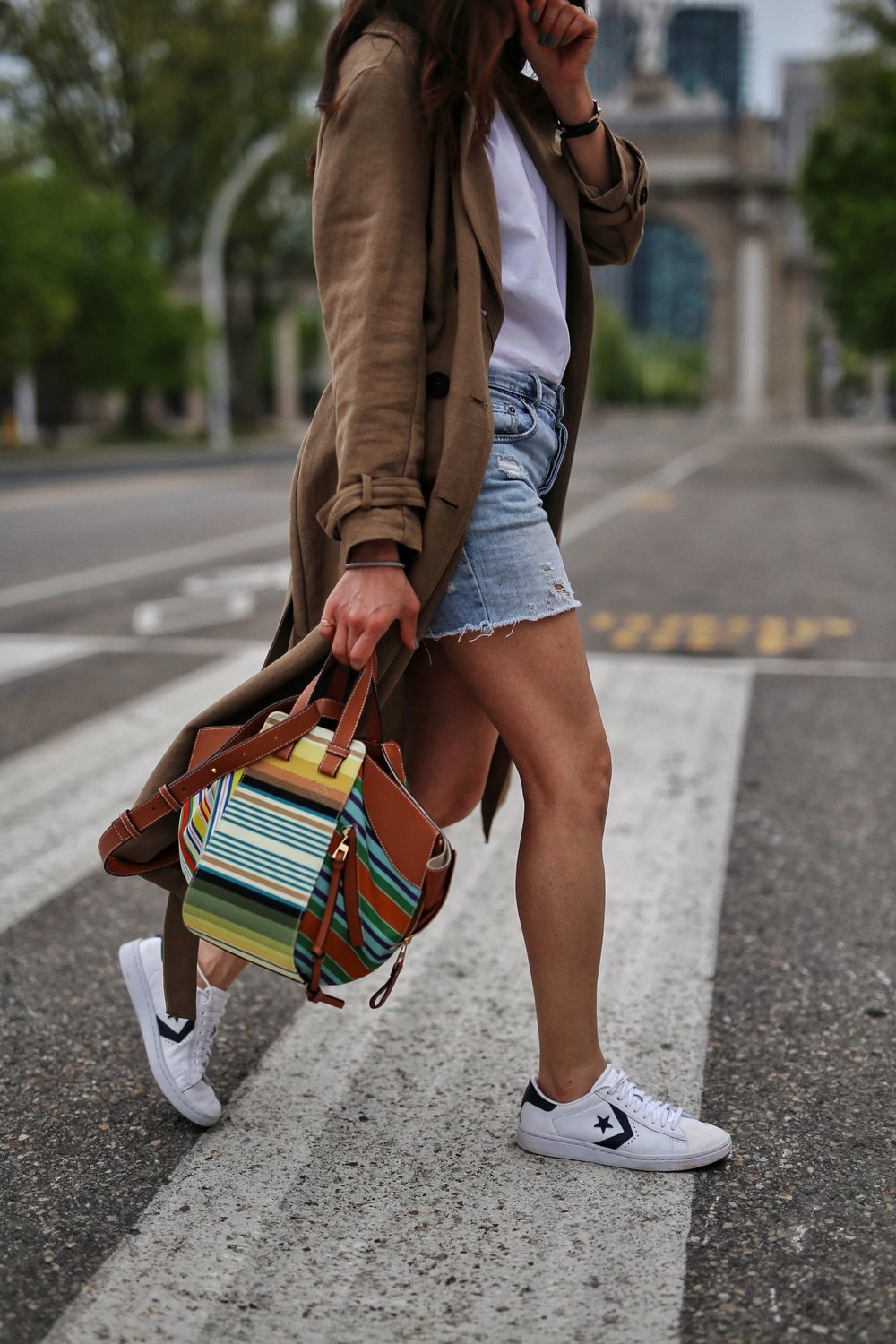 woahstyle.com 2018 - zara linen trench coat, free people cut off shorts, converse one stars, loewe striped small hammock bag, white button up shirt - toronto street style - hotel x - nathalie martin 13.jpg