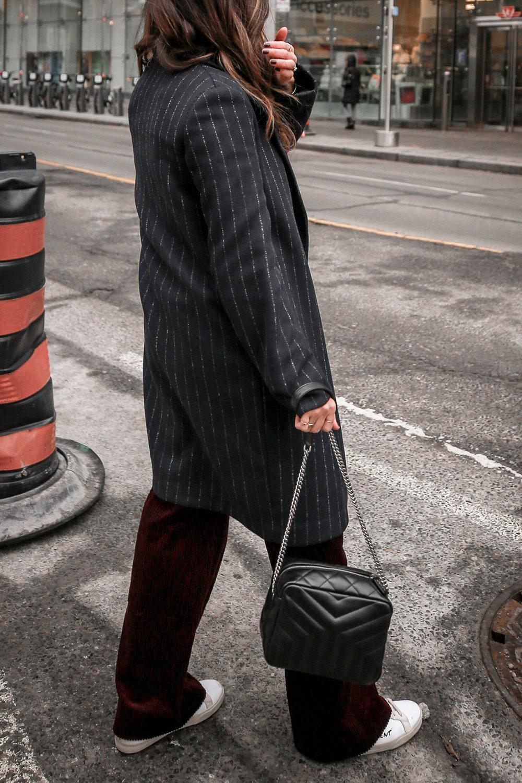Nathalie Martin Sandro corduroy high waisted pants, Aritzia pinstriped wool Stedman coat, Frank & Oak sweatshirt, Saint Laurent canvas sneakers and small LouLou Bowling Bag, streetstyle, woahstyle.com_4206.jpg